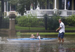 Don Dressler pulls his granddaughters Elsie and Jillian Deans on a kayak through the water on Avenue L after the rain from Tropical Storm Imelda stopped in Galveston, Texas on Wednesday, Sept. 18, 2019. After a downpour, the rain stopped and street flooding went down significantly. (Kelsey Walling/The Galveston County Daily News via AP)