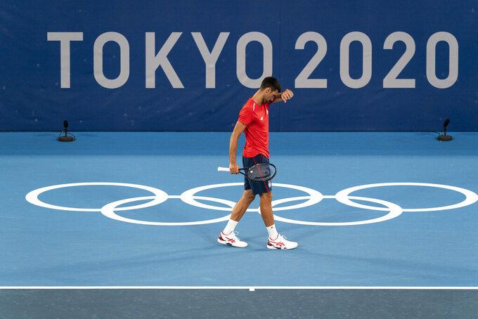 Novak Djokovic, of Serbia, practices at the Ariake Tennis Center ahead of the 2020 Summer Olympics, Wednesday, July 21, 2021, in Tokyo, Japan. (AP Photo/Alex Brandon)