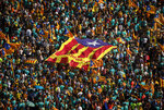 Protesters hold esteladas or independence flags as they take part in a demonstration during the Catalan National Day in Barcelona, Spain, Wednesday, Sept. 11, 2019. Thousands of Spaniards who support the secession of Catalonia are gathering in Barcelona on the region's main holiday, just weeks before a highly anticipated verdict in a case against 12 leaders of the separatist movement. (AP Photo/Emilio Morenatti)