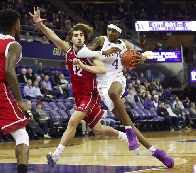 Washington forward Jaden McDaniels (4) drives against South Dakota's Hunter Goodrick (12) during the first half of an NCAA college basketball game, Monday, Dec. 2, 2019, in Seattle. (Ken Lambert/The Seattle Times via AP)