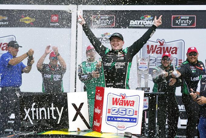 Justin Haley celebrates in Victory Lane after winning the NASCAR Xfinity Series auto race at Daytona International Speedway, Saturday, Aug. 28, 2021, in Daytona Beach, Fla. (AP Photo/John Raoux)