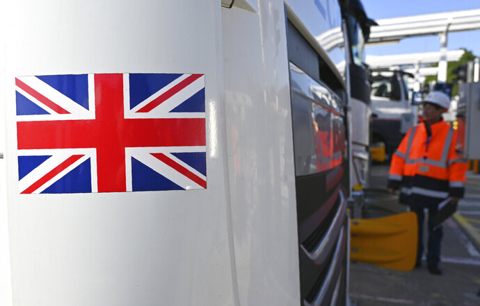 An employee of Eurotunnel checks a British truck on its way to France during a day of test in case of no deal Brexit at the entrance of the Channel tunnel in Folkestone, Tuesday, Sept. 17, 2019. British Prime Minister Boris Johnson has said after a meeting with European Commission President Jean-Claude Juncker that