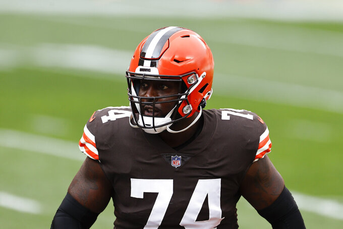 FILE - In this Oct. 11, 2020, file photo, Cleveland Browns offensive tackle Chris Hubbard (74) warms up before an NFL football game against the Indianapolis Colts in Cleveland. Versatile offensive lineman Hubbard's season is likely over after he suffered a serious knee injury early in a win over the New York Giants on Sunday, Dec. 20, 2020. (AP Photo/Ron Schwane, File)