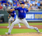 Texas Rangers starting pitcher Mike Minor delivers to a Kansas City Royals batter during the first inning of a baseball game at Kauffman Stadium in Kansas City, Mo., Wednesday, May 15, 2019. (AP Photo/Orlin Wagner)