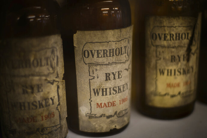 Bottles of Overheat Rye Whiskey from 1905 are on display at the West Overton Village's Distillery Museum on Thursday, June 13, 2019, at the West Overton Village in Scottsdale. West Overton Village was founded in 1800 and grew into a self-sufficient village via distilling rye whiskey. This summer, the museum will start producing rye whiskey in their new still as part of the visitor experience. (Stephanie Strasburg/Pittsburgh Post-Gazette via AP)