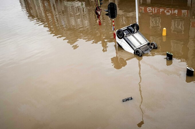FILE - In this Friday, July 16, 2021 file photo, a car sits submerged in the water after flooding in Chenee, Province of Liege, Belgium. Scientists say there's something different this year from the recent drumbeat of climate weirdness. This summer a lot of the places hit by weather disasters are not used to getting extremes and many of them are wealthier, which is different from the normal climate change victims. That includes unprecedented deadly flooding in Germany and Belgium, 116-degree heat records in Portland, Oregon and similar blistering temperatures in Canada, along with wildfires. Now Southern Europe is seeing scorching temperatures and out-of-control blazes too. And the summer of extremes is only getting started. Peak Atlantic hurricane and wildfire seasons in the United States are knocking at the door. (AP Photo/Valentin Bianchi, File)