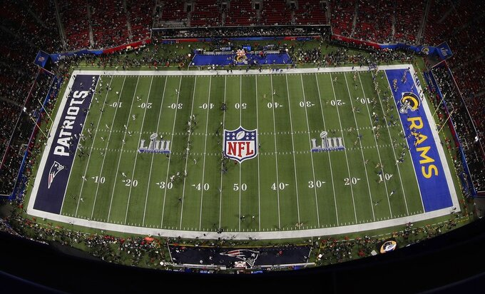Players warm up before the NFL Super Bowl 53 football game between the Los Angeles Rams and the New England Patriots, Sunday, Feb. 3, 2019, in Atlanta. (AP Photo/Morry Gash)