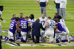 Tennessee Titans and the Minnesota Vikings players meet at midfield following an NFL football game, Sunday, Sept. 27, 2020, in Minneapolis. Tennessee won 31-30. The NFL says the Tennessee Titans and Minnesota Vikings are suspending in-person activities after the Titans had three players test positive for the coronavirus, along with five other personnel. The league says both clubs are working closely with the NFL and the players' union on tracing contacts, more testing and monitoring developments. The Titans are scheduled to host the Pittsburgh Steelers on Sunday.(AP Photo/Jim Mone)