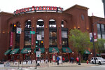 People walk outside Busch Stadium after the scheduled start of a baseball game between the St. Louis Cardinals and the New York Mets Tuesday, May 4, 2021, in St. Louis. The game has been rained out and the two teams will play a doubleheader on Wednesday. (AP Photo/Jeff Roberson)