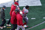 Indiana quarterback Michael Penix Jr. (9) is helped off the field after getting injured in the second half of an NCAA college football game against Maryland, Saturday, Nov. 28, 2020, in Bloomington, Ind. Indiana won 27-11. (AP Photo/Darron Cummings)