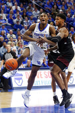 Kentucky's Immanuel Quickley, left, is fouled by Mississippi State's Iverson Molinar during the second half of an NCAA college basketball game in Lexington, Ky., Tuesday, Feb. 4, 2020. Kentucky won 80-72. (AP Photo/James Crisp)