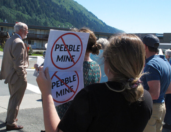 FILE - This June 25, 2019, file photo shows people gathered outside U.S. Sen. Lisa Murkowski's office in Juneau, Alaska, to protest the proposed Pebble Mine. The U.S. Environmental Protection Agency announced Thursday, Sept. 9, 2021, it would seek to restart a process that could restrict mining in Alaska's Bristol Bay region, which is renowned for its salmon runs. The announcement is the latest in a long-running dispute over a proposed copper-and-gold mine in the southwest Alaska region. (AP Photo/Becky Bohrer, File)