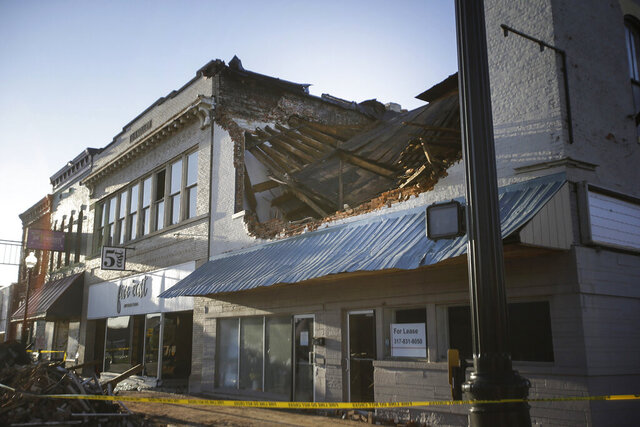 A building that was damaged from Wednesday's storm is seen on Thursday, April 9, 2020, in Mooresville, Ind. Severe storms with high winds, hail and possible tornadoes swept across the Midwest and caused damage to dozens of homes and businesses in parts of Indiana and Arkansas. A few injuries were reported following Wednesday night's storms and the threat of more severe weather was forecast for the coming days throughout much of the United States. (Clark Wade/The Indianapolis Star via AP)
