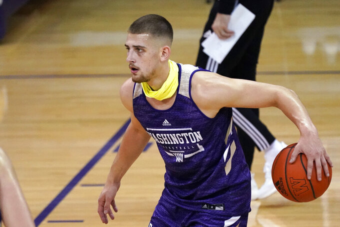 Washington's Erik Stevenson dribbles during an NCAA college basketball practice Tuesday, Oct. 27, 2020, in Seattle. Stevenson is among several transfers to Washington who the Huskies are hopeful can all make an immediate impact. (AP Photo/Elaine Thompson)