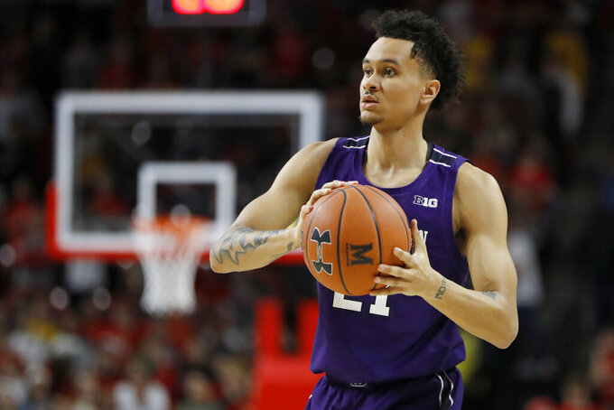 Northwestern forward A.J. Turner works the floor against Maryland during the first half of an NCAA college basketball game, Tuesday, Feb. 18, 2020, in College Park, Md. (AP Photo/Julio Cortez)
