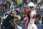 Arizona Cardinals running back Kenyan Drake fends off Seattle Seahawks linebacker Mychal Kendricks, left, as he rushes during the second half of an NFL football game, Sunday, Dec. 22, 2019, in Seattle. (AP Photo/Lindsey Wasson)