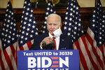 Democratic presidential candidate, former Vice President Joe Biden removes his mask as he speaks in Philadelphia, Tuesday, June 2, 2020. (AP Photo/Matt Rourke)