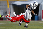 Utah State running back Jaylen Warren (20) is tackled by New Mexico safety Johnny Hernandez (32) during the second half of an NCAA college football game on Saturday, Nov. 30, 2019 in Albuquerque, N.M. (AP Photo/Andres Leighton)