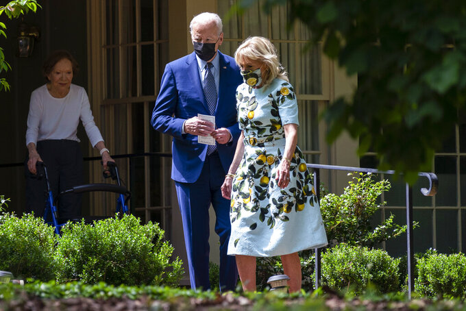 Former first lady Rosalynn Carter looks on as President Joe Biden and first lady Jill Biden leave the home of former President Jimmy Carter during a trip to mark Biden's 100th day in office, Thursday, April 29, 2021, in Plains, Ga. (AP Photo/Evan Vucci)