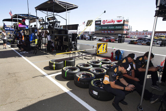 Pit crews await a NASCAR Cup Series auto race, Sunday, June 6, 2021, at Sonoma Raceway in Sonoma, Calif. (AP Photo/D. Ross Cameron)