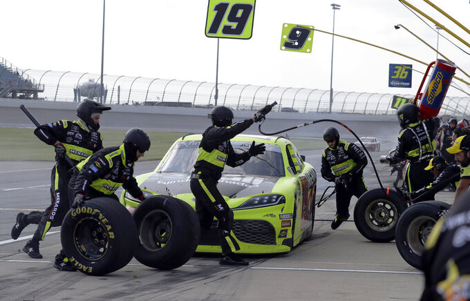 Brandon Jones makes a pit stop during the NASCAR Xfinity Series auto race at Chicagoland Speedway in Joliet, Ill., Saturday, June 29, 2018. (AP Photo/Nam Y. Huh)