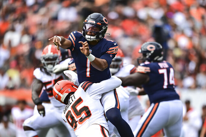 Chicago Bears quarterback Justin Fields (1) is hit by Chicago Bears defensive tackle Khyiris Tonga (95) after a pass during the second half of an NFL football game, Sunday, Sept. 26, 2021, in Cleveland. (AP Photo/David Dermer)