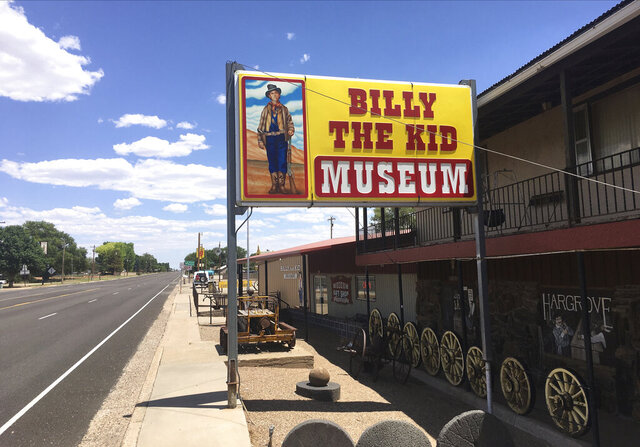 """In this photo provided by the Billy The Kid Museum, a sign stands outside the museum in Fort Sumner, N.M., in De Baca county, Thursday, July 9, 2020. De Baca is one of two counties in the state where no coronavirus cases have been confirmed. """"Most everybody tries to respect each other's space,"""" says Tim Sweet, who runs the museum. (Tim Sweet/Billy The Kid Museum via AP)"""
