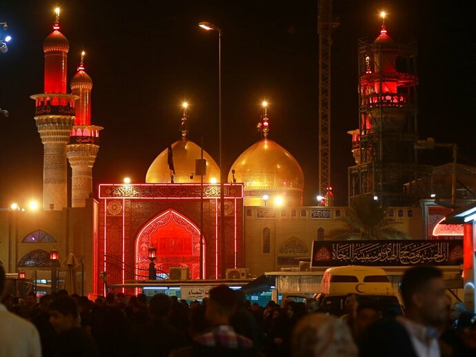 Shiite Muslims gather outside the golden-domed shrine of Imam Moussa al-Kadhim during a Muharram procession in Baghdad, Iraq, Monday, Sept. 9, 2019. Muharram, the first month of the Islamic calendar, is a month of mourning for Shiites in remembrance of the death of Hussein, the grandson of the Prophet Muhammad, at the Battle of Karbala in present-day Iraq in the 7th century. (AP Photo/Khalid Mohammed)