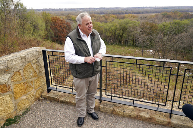 Interior Secretary David Bernhardt takes reporters' questions overlooking the Minnesota River area after he announced the gray wolf's recovery
