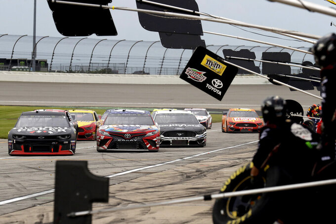 Drivers move down pit road for a pit stop during a NASCAR Cup Series auto race at Chicagoland Speedway in Joliet, Ill., Sunday, June 30, 2019. (AP Photo/Nam Y. Huh)