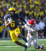 Michigan wide receiver Cornelius Johnson (6) rushes after a 23-yard reception while defended by Rutgers linebacker Olakunle Fatukasi (3) in the second quarter of an NCAA college football game in Ann Arbor, Mich., Saturday, Sept. 25, 2021. (AP Photo/Tony Ding)