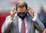Alabama head coach Nick Saban Saban puts his mask back on after a pregame interview before an NCAA college football game against Kentucky at Bryant-Denny Stadium, Saturday, Nov. 21, 2020, in Tuscaloosa, Ala. (Mickey Welsh/The Montgomery Advertiser via AP)