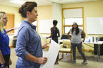 Michigan democratic gubernatorial candidate Gretchen Whitmer gets ready to cast ballot, Tuesday, Aug. 7, 2018, at St. Paul Lutheran church in East Lansing, Mich. Behind her is daughter Sydney Shrewsbury, 14. (Matthew Dae Smith/Lansing State Journal via AP)