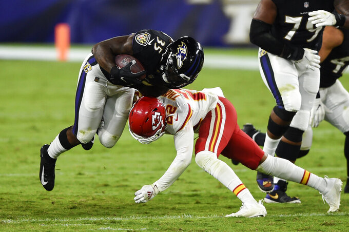 Baltimore Ravens running back Gus Edwards (35) is hit by Kansas City Chiefs free safety Juan Thornhill (22) during the second half of an NFL football game Monday, Sept. 28, 2020, in Baltimore. (AP Photo/Gail Burton)