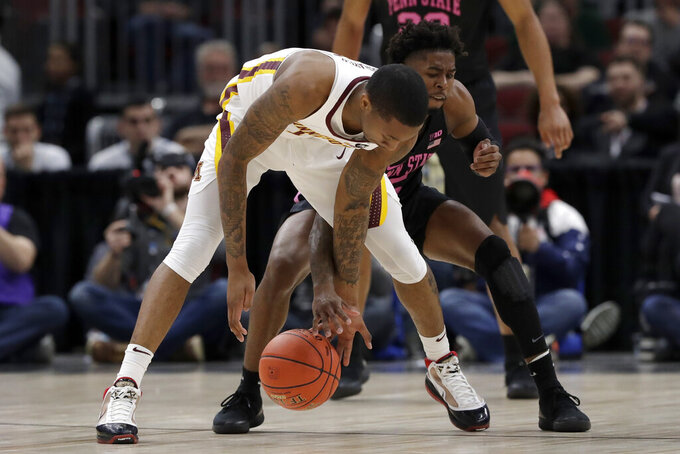 Penn State's Jamari Wheeler, right steals the ball from Minnesota's Dupree McBrayer (1) during the first half of an NCAA college basketball game in the second round of the Big Ten Conference tournament, Thursday, March 14, 2019, in Chicago. (AP Photo/Nam Y. Huh)