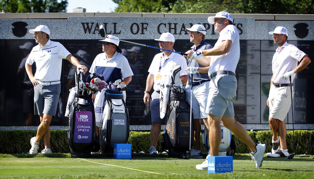 Jordan Spieth, left, watches Ryan Palmer tee off the first hole during practice for the Charles Schwab Challenge golf tournament at the Colonial Country Club in Fort Worth, Texas, Tuesday, June 9, 2020. The Challenge is the first PGA tour event since the COVID-19 pandemic began. (Tom Fox/The Dallas Morning News via AP)