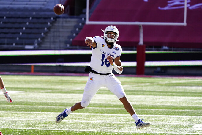San Jose State quarterback Nick Nash throws off-balance against Ball State in the first half of the Arizona Bowl NCAA college football game, Thursday, Dec. 31, 2020, in Tucson, Ariz. (AP Photo/Rick Scuteri)
