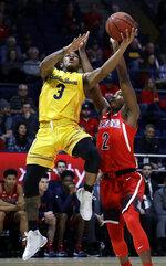 California's Paris Austin, left, shoots over Arizona's Brandon Williams (2) during the first half of an NCAA college basketball game Saturday, Jan. 12, 2019, in Berkeley, Calif. (AP Photo/Ben Margot)