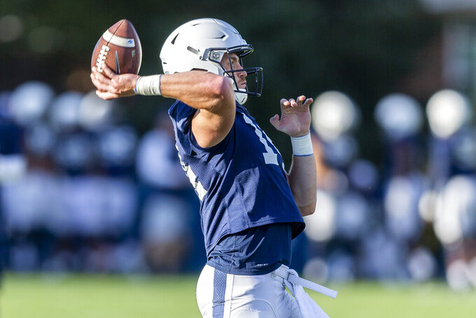 Penn State quarterback Sean Clifford throws during the NCAA college football team's practice Tuesday, Sept. 24, 2019, in State College, Pa. (Joe Hermitt/The Patriot-News via AP)