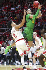 Oregon guard Will Richardson (0) is fouled by Utah guard Sedrick Barefield (2) during the first half of an NCAA college basketball game Thursday, Jan. 31, 2019, in Salt Lake City. (AP Photo/Chris Nicoll)