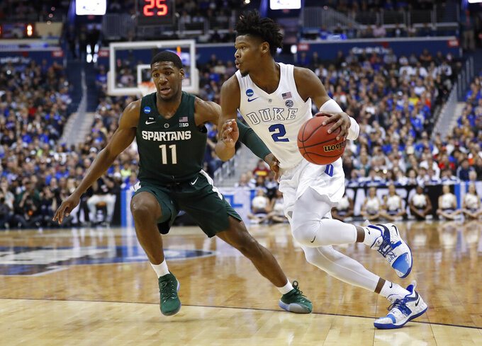 Duke forward Cam Reddish (2) drives around Michigan State forward Aaron Henry (11) during the first half of an NCAA men's East Regional final college basketball game in Washington, Sunday, March 31, 2019. (AP Photo/Patrick Semansky)