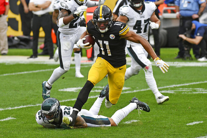 Pittsburgh Steelers wide receiver Chase Claypool (11) gets past Philadelphia Eagles safety Marcus Epps (22) after taking a pass from quarterback Ben Roethlisberger for a touchdown during the first half of an NFL football game in Pittsburgh, Sunday, Oct. 11, 2020. (AP Photo/Don Wright)