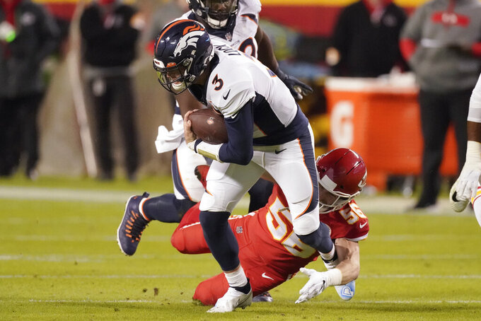 Kansas City Chiefs outside linebacker Ben Niemann (56) tackles Denver Broncos quarterback Drew Lock (3) in the first half of an NFL football game in Kansas City, Mo., Sunday, Dec. 6, 2020. (AP Photo/Charlie Riedel)