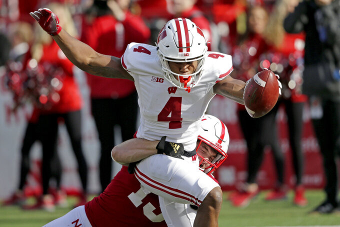 Taylor over 200 again in No. 15 Badgers' 37-21 win over Neb