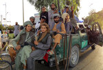 Taliban fighters patrol inside the city of Kandahar province southwest, of Afghanistan, Sunday, Aug. 15, 2021. (AP Photo/Sidiqullah Khan)