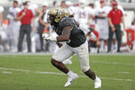 FILE - In this Sept. 14, 2019 file photo, Central Florida linebacker Eriq Gilyard rushes the Stanford line during the second half of an NCAA college football game in Orlando, Fla.  Georgia Tech hosts Central Florida on Saturday, Sept. 19, 2020.(AP Photo/John Raoux, File)