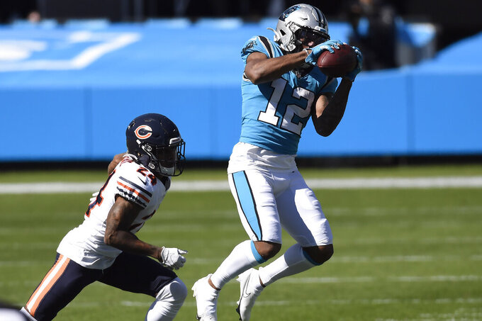 Carolina Panthers wide receiver D.J. Moore (12) catches a pass while Chicago Bears cornerback Buster Skrine (24) defends during the first half of an NFL football game in Charlotte, N.C., Sunday, Oct. 18, 2020. (AP Photo/Mike McCarn)