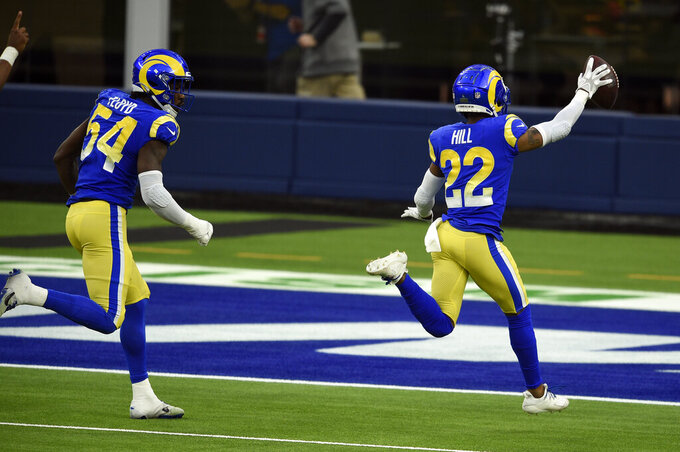 Los Angeles Rams cornerback Troy Hill (22) runs back with a recovered fumble for a touchdown during the second half of an NFL football game against the San Francisco 49ers Sunday, Nov. 29, 2020, in Inglewood, Calif. (AP Photo/Kelvin Kuo)