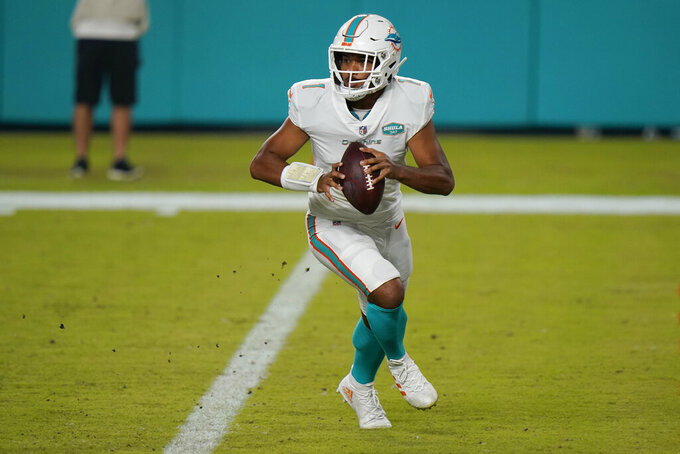Miami Dolphins quarterback Tua Tagovailoa (1) looks to pass the ball during the second half of an NFL football game against the New York Jets, Sunday, Oct. 18, 2020, in Miami Gardens, Fla. Hopes are high Tagovailoa will be the best of the 22 quarterbacks to start for Miami since Dan Marino retired following the 1999 season. (AP Photo/Lynne Sladky)