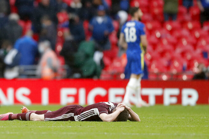 Leicester's Jamie Vardy, on the ground, reacts at the end of the FA Cup final soccer match between Chelsea and Leicester City at Wembley Stadium in London, England, Saturday, May 15, 2021. Leicester won 1-0. (Matt Childs/Pool via AP)